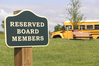 Board sign and schoolbus