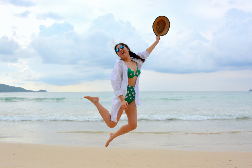 Girl-jumping-for-joy-on-the-beach